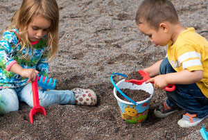 Children digging in the soil.