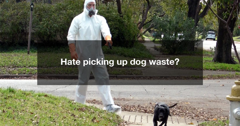 Image of man walking dog in full hazmat suit