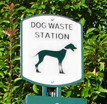 Useless sign topping a dog waste station.